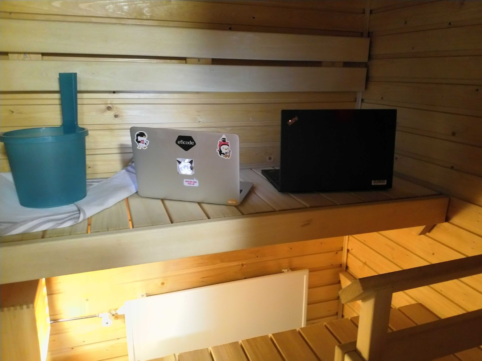 An empty sauna with two laptops