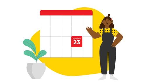 Kuvassa nainen osoittaa kalenteria