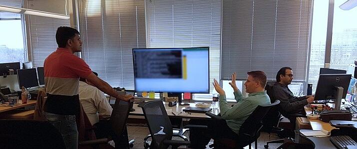Three men discussing in an office room