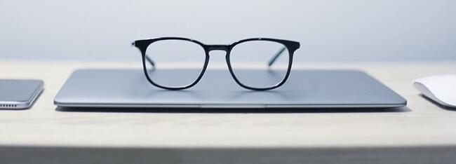 glasses on the table reflecting looking ahead