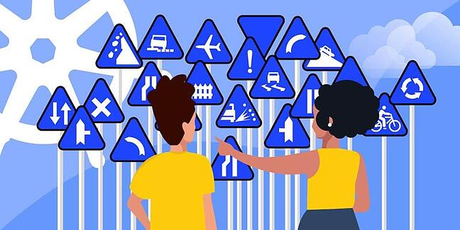 Two persons look at a big bunch of blue traffic signs with the kubernetes helm logo in the background