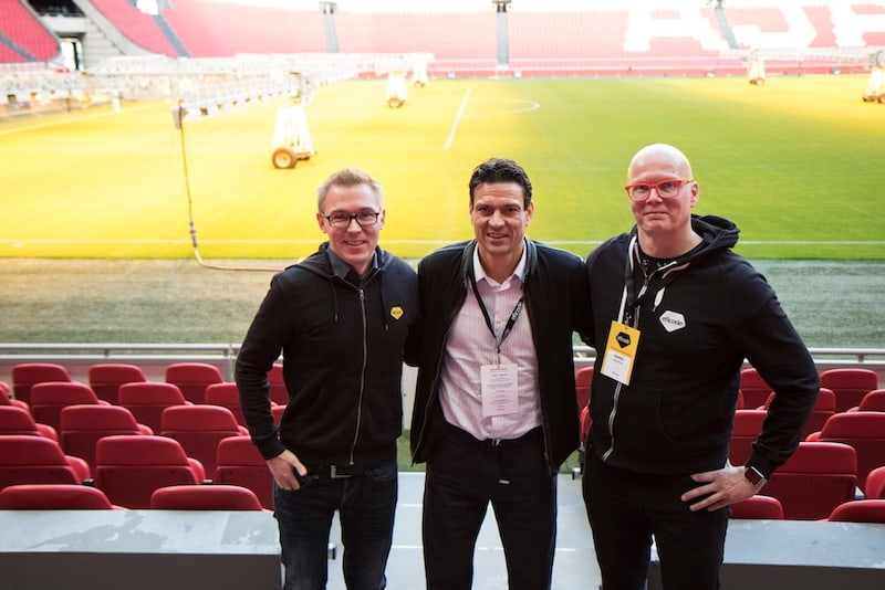Jari Litmanen stands in the middle flanked by Eficode's CEO Risto Virkkala and CCO Heikki Hämäläinen