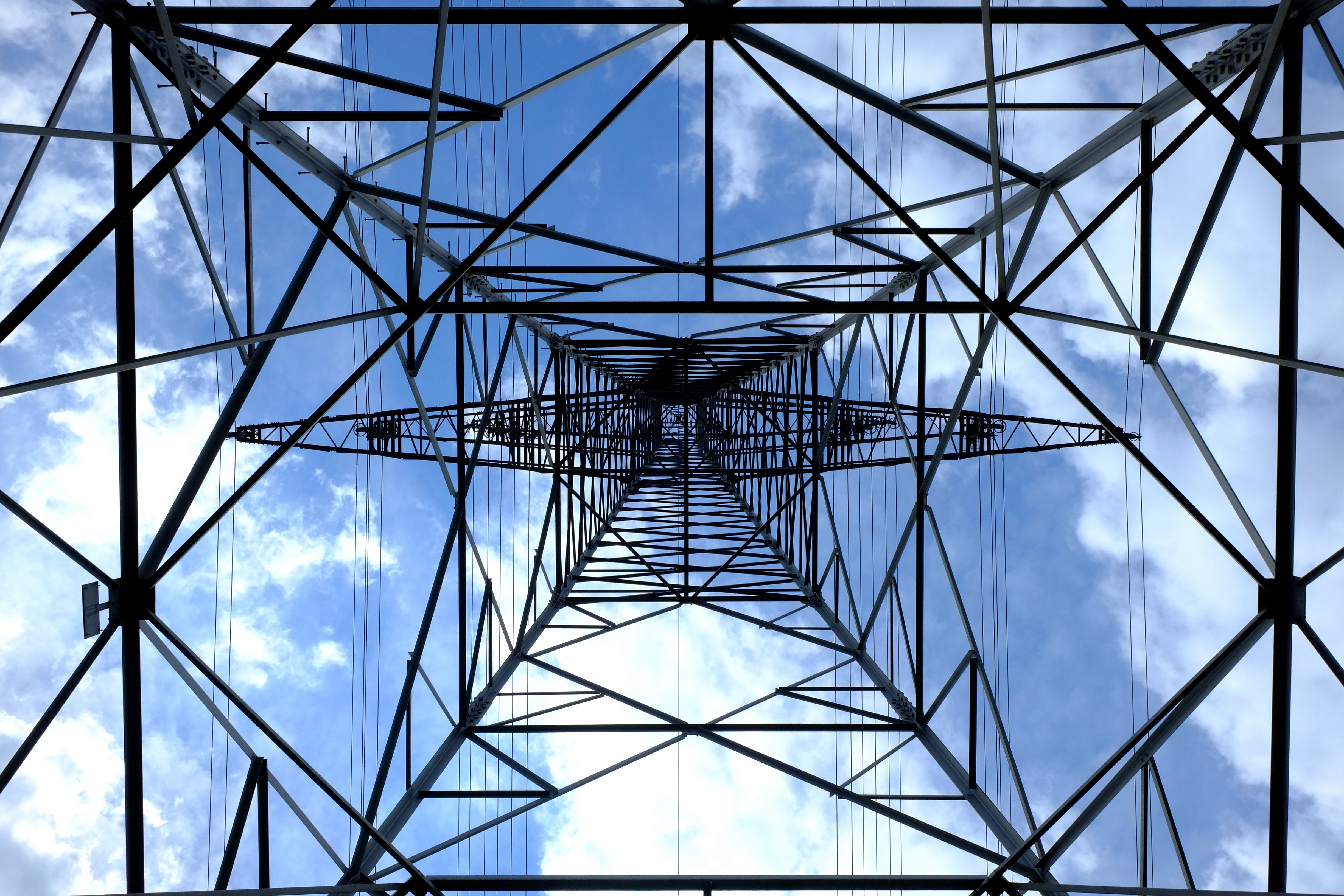 electric tower seen from below growing towards the sky